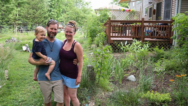 Paul Patterson and Ann Deutermann stand in the raingarden they built in their backyard. The garden keeps rainwater from polluting nearby bodies of water.