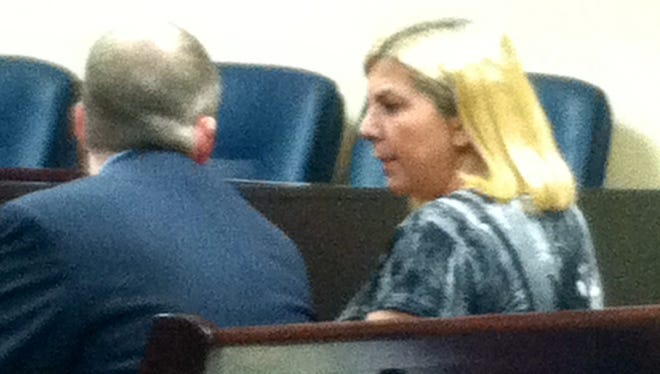 Bloomfield Township resident Tricia Ann Kortes in court Thursday with defense attorney Gerald Gleeson.