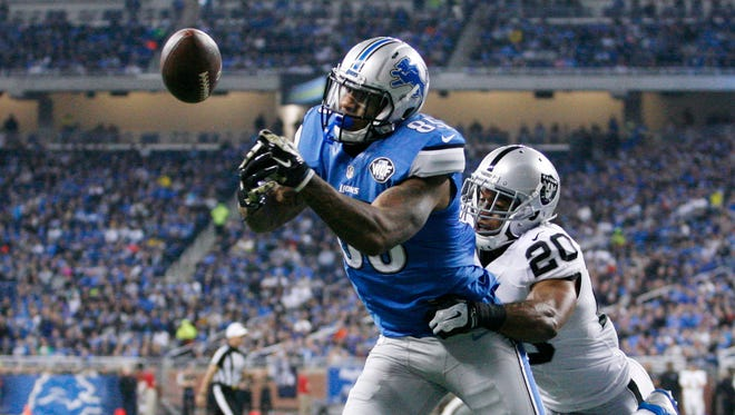 Nov 22, 2015; Detroit, MI, USA; Detroit Lions tight end Eric Ebron (85) attempts to catch the ball as Oakland Raiders strong safety Nate Allen (20) defends during the first quarter at Ford Field.