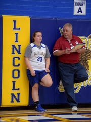 Lincoln's Kerrigan Neff talks with coach Rob Bills