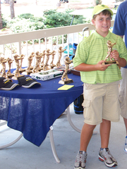 Ochsenreiter holds up a trophy at a tournament in Florida.