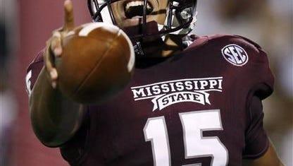 Mississippi State quarterback Dak Prescott will lead the team's high-octane offense this season.