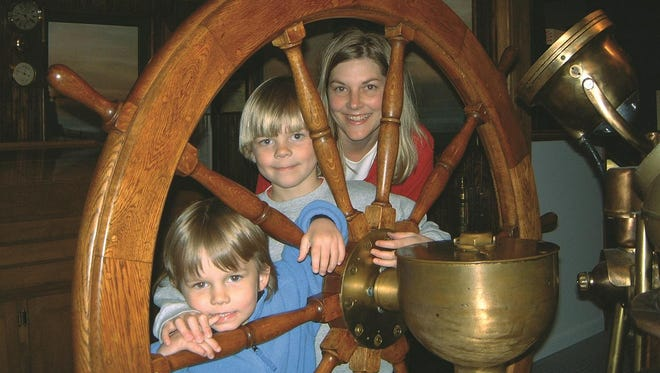 Children get ready to take the wheel of the virtual freighter Elba, one of the attractions at the Door County Maritime Museum, which offers free children's admissions with a paid adult admission Oct. 15, 22 and 29.