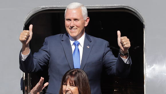 Indiana Gov. Mike Pence reacts with his wife, Karen,