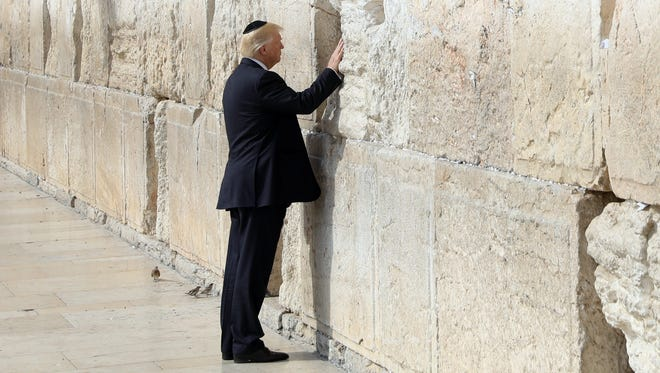 Trump touches the Western Wall in Jerusalem's Old City on May 22, 2017.