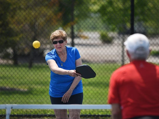 Pickleball advocates Iris Borman of Cliffside Park and  Norm Levy of Fort Lee (foreground) play Pickleball together on a concrete surface at Overpeck Park in Ridgefield Park on 05/15/18.