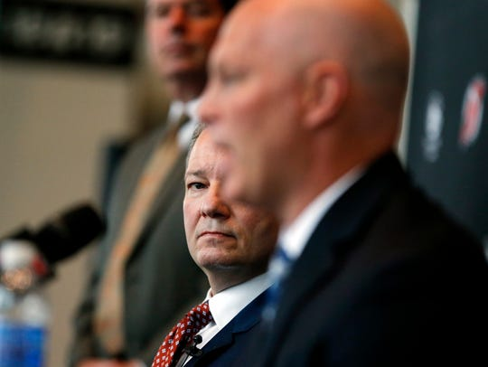 Devils general manager Ray Shero, center, and head