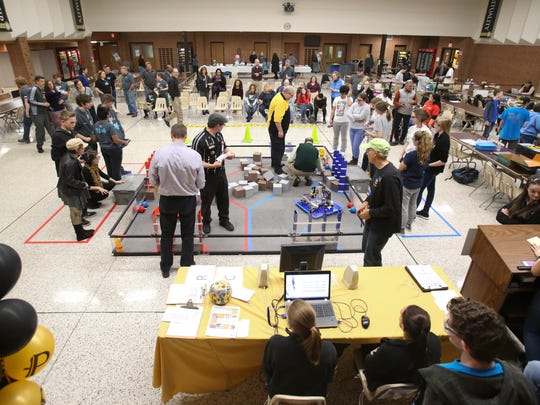 Teams try out their robots during a First Tech Challenge