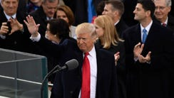 President Donald Trump acknowledges the crowd after