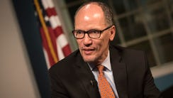 Democratic National Chairman Tom Perez speaks with