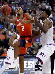 Clemson's Marcquise Reed (2) heads to the basket as Kansas' Udoka Azubuike defends during the second half of a regional semifinal game in the NCAA men's college basketball tournament Friday, March 23, 2018, in Omaha, Neb. (AP Photo/Nati Harnik)