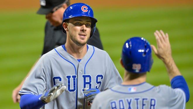 Cubs third baseman Kris Bryant, left, celebrates his grand slam in the ninth inning.