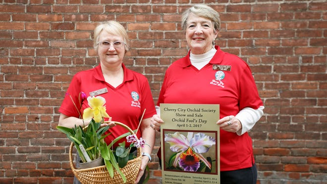 Janeil Payne, left, and Rickie Hart, right, with the Cherry City Orchid Society at Holding Court on Tuesday, March 28, 2017.