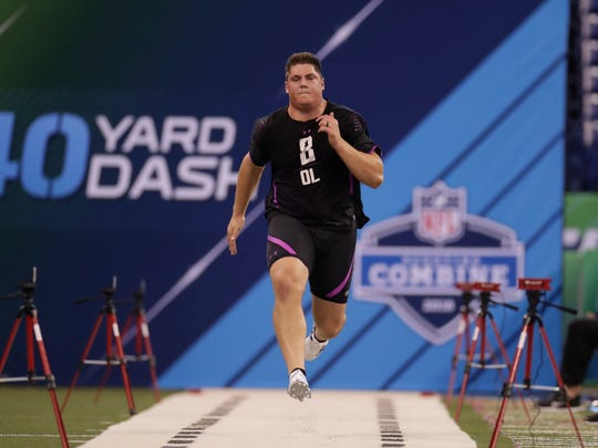 Nevada offensive lineman Austin Corbett runs the 40-yard dash at the NFL football scouting combine in Indianapolis on Friday.