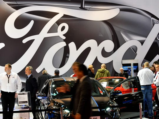 Visitors are seen at the stand of car maker Ford during the 'Essen Motor Show' fair in Essen, western Germany, on December 1, 2017. According to the organisers, more than 500 exhibitors will present their innovations and premieres at the fair grounds in Essen from December 2 to 10, 2017.