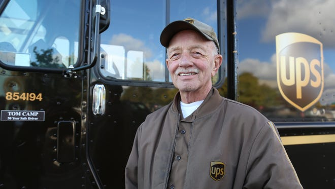 Tom Camp, 73, poses in front of a UPS truck in Livonia, Mich., on Oct. 25, 2013.