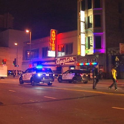 A woman was shot and killed inside Augie's bar in downtown