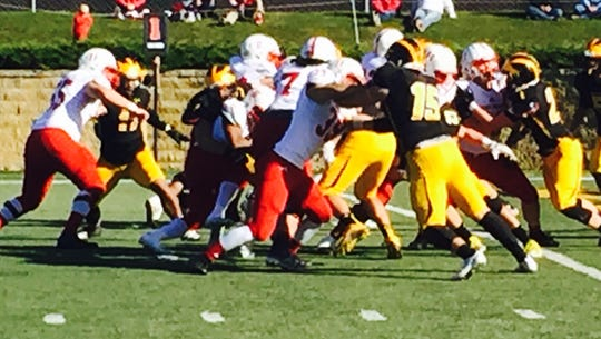The Johnnies offensive line surges forward in the third