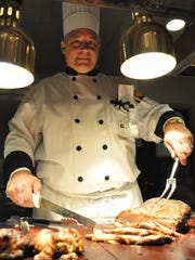 Shields is shown cutting meat at the Market Place Buffet.