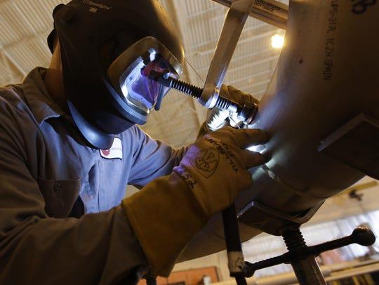 Fitter Eric Malouf welds at Team Industries in Kaukauna.