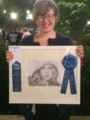 General exhibits give residents of all ages a chance to shine. Emma Bruggemeyer won Best in Show for the drawing she submitted to the art show at a past Harvest Home Fair.