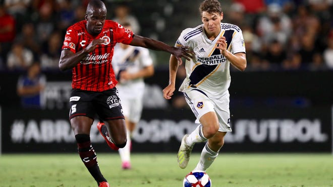 Ormond Beach's Kai Koreniuk (right), who signed a pro contract with LA Galaxy on June 25, could make his MLS debut in his home state. The MLS Is Back Tournament starts this week in Orlando.
