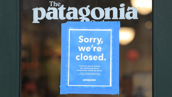 """FILE - This April 9, 2020 file photo shows a closed Patagonia clothing store in Freeport, Maine. The outdoor gear company Patagonia is the latest brand to announce an advertising boycott of Facebook and its Instagram app, saying the social media giant has """"failed to take steps to stop the spread of hateful lies and dangerous propaganda on its platform."""" Patagonia joins The North Face and the outdoor gear company REI, which have announced similar boycotts in recent days. It is not clear how much the boycotts will affect Facebook's advertising revenue, which was nearly $70 billion in 2019, making up nearly all of its total revenue."""