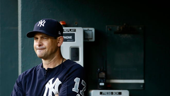 New York Yankees manager Aaron Boone stands in the dugout before a baseball game against the Baltimore Orioles, Tuesday, July 10, 2018, in Baltimore. Baltimore won 6-5.