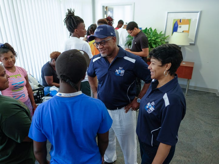 Jackson State University President William Bynum, center,