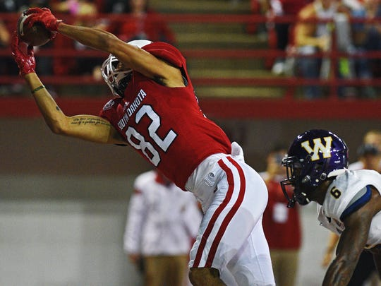 USD's Dakarai Allen (82) brings in a touchdown pass during a game against Western Illinois Saturday, Oct. 29, 2016, at the DakotaDome on the University of South Dakota campus in Vermillion, S.D.