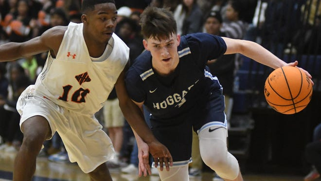 Hoggard's Brady Rankin drives to the basket against New Hanover during the finals of the 2020 Mideastern Conference tournament at Brunswick Community College in February.