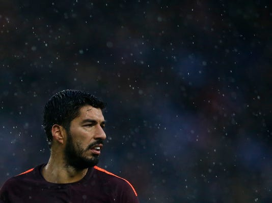 FC Barcelona's Luis Suarez looks on during the Spanish La Liga soccer match between Espanyol and FC Barcelona at RCDE stadium in Cornella Llobregat, Spain, Sunday, Feb. 4, 2018. (AP Photo/Manu Fernandez)