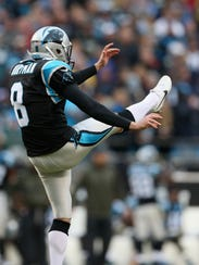 Brad Nortman punts during the Panthers-Packers game