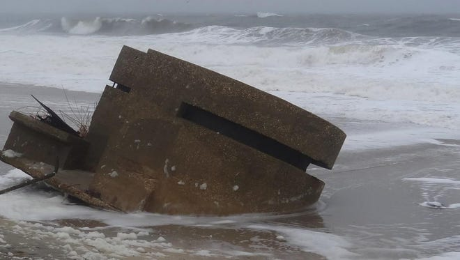 A military pillbox on the fishing beach at Sandy Hook. Severe weather, including superstorm Sandy in 2012, has been wearing down the decommissioned Fort Hancock.