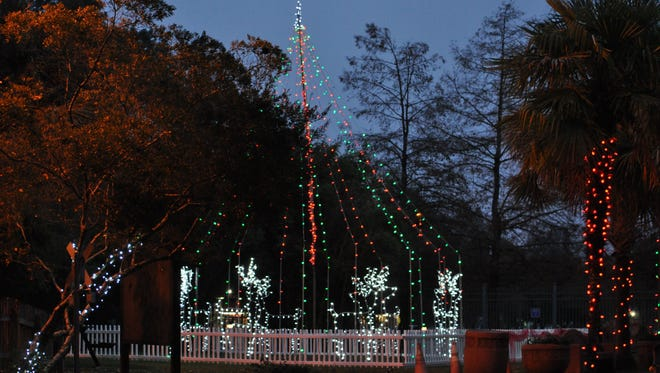 The entrance of the Alexandria Zoo lit up for the annual Holiday Light Safari.