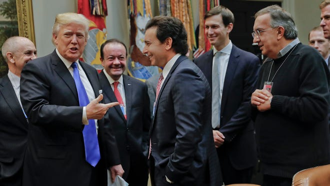 President Donald Trump points to Ford Motors CEO Mark Fields, center, at the start of a meeting with automobile leaders in the Roosevelt Room of the White House in Washington, Tuesday, Jan. 24, 2017. Also at the meeting are Fiat Chrysler Automobiles CEO Sergio Marchionne, right, and White House Senior Adviser Jared Kushner, second from the right.