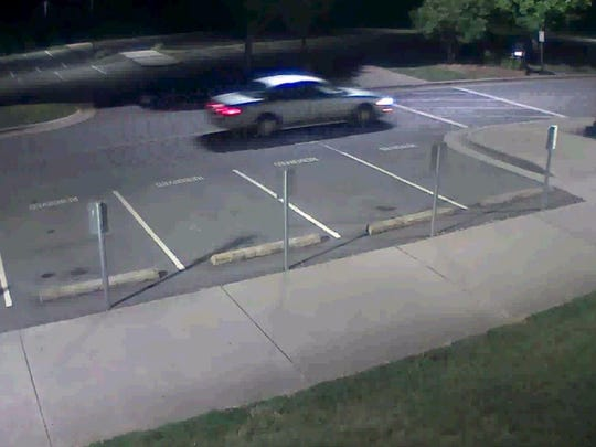 Surveillance image related to a suspect wanted in connection with a series of break-ins at Buncombe County high schools.
