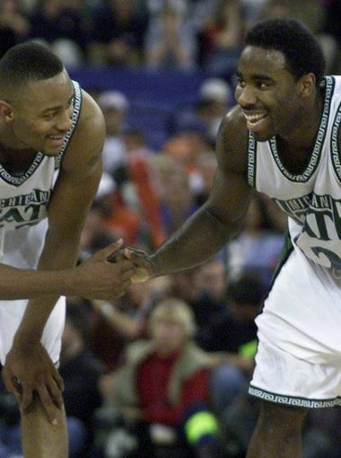 Morris Peterson and Mateen Cleaves celebrate at mid-court with a little over one minute to go in their Saturday night game against Wisconsin.  MSU won 53-41 and will play the winner of UNC and Florida on Monday night.