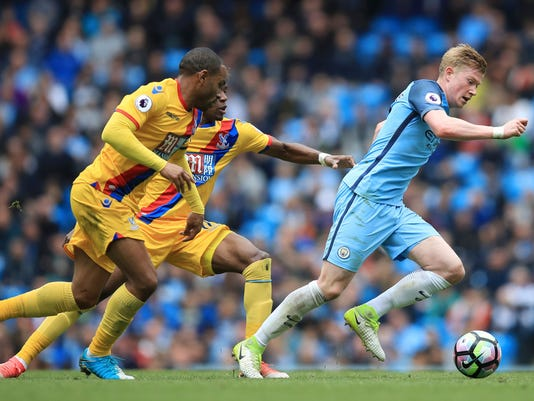 Manchester City's Kevin De Bruyne, right, breaks with the ball during the Premier League soccer match between Manchester City and Crystal Palace at The Etihad Stadium, Manchester, England. Saturday May 6, 2017. (Mike Egerton/PA via AP)