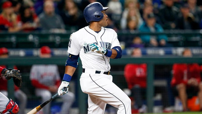 May 2, 2017; Seattle, WA, USA; Seattle Mariners second baseman Robinson Cano (22) hits a double against the Los Angeles Angels during the first inning at Safeco Field. Mandatory Credit: Joe Nicholson-USA TODAY Sports