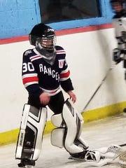 Brendan O'Callaghan on the ice for his hockey team.