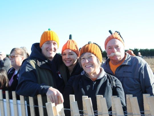 "Tyson Bohl and Andria Burke, along with Kathy and Don Bohl, wear their handmade ""Punkin Hats"" during the 2016 World Championship Punkin Chunkin."