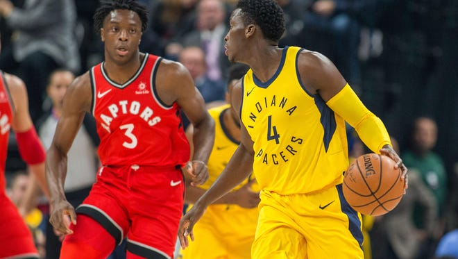 Nov 24, 2017; Indianapolis, IN, USA; Indiana Pacers guard Victor Oladipo (4) dribbles the ball against Toronto Raptors forward OG Anunoby (3) in the first quarter at Bankers Life Fieldhouse.