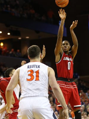 Feb 6, 2017; Charlottesville, VA, USA; Louisville Cardinals forward V.J. King (0) shoots the ball as Virginia Cavaliers forward Jarred Reuter (31) looks on in the first half at John Paul Jones Arena. Mandatory Credit: Geoff Burke-USA TODAY Sports