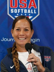 Pitcher Cat Osterman smiles as she answers a question during a news conference to announce the USA Softball 2020 Women's Olympic Team, Tuesday, Oct. 8, 2019, in Oklahoma City. (AP Photo/Sue Ogrocki)