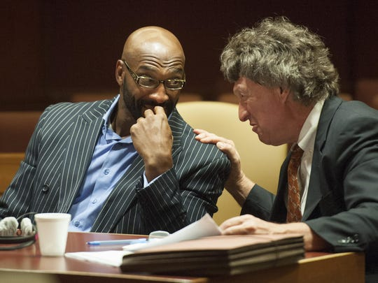 Former Philadelphia Eagles wide receiver Irving Fyar, left, listens to attorney Michael Gilberti during his trial in 2015.