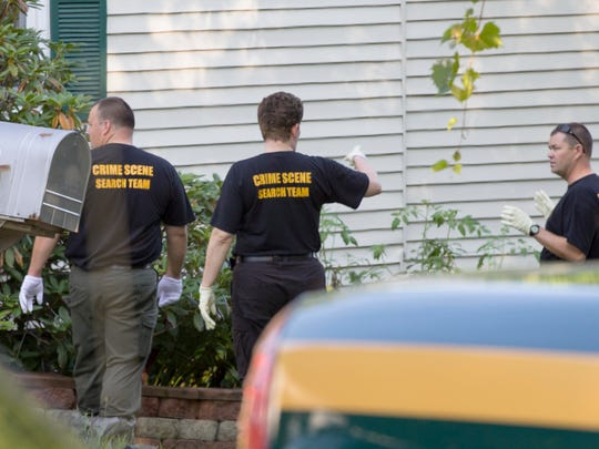Members of the Vermont State Police Crime Scene Search Team search for evidence Friday following a shooting incident Thursday night after an argument between a man and his girlfriend broke out at 62 Pine Street in Bristol.