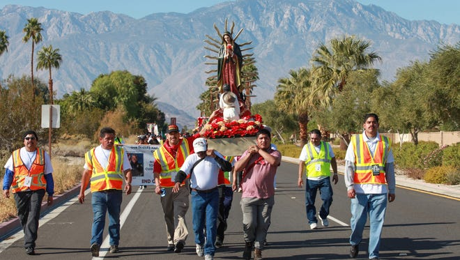 People carry the Virgin de Guadalupe during a pilgrimage from Palm Springs to Coachella, December 12, 2016.