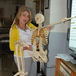 April Winstead, a biology teacher at Ruston High School, holds her class mascot. Winstead is a finalist for the Louisiana Teacher of the Year award.