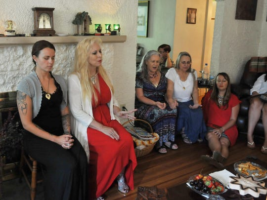 Those attending meditated and listened to chanting. Seated closest to camera is Brittany Morley who guided them in the meditation and Morgana Starr, a psychic medium.